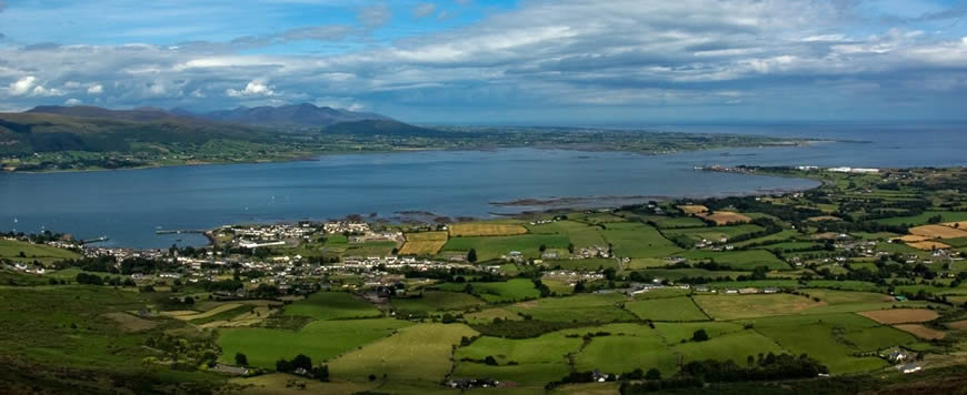 The view from Slieve Foye looking down at Carlingford and across to the Mourne Mountains